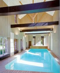 elegant best indoor pool with wall murals and mosaic glass tiles amusing best indoor pool with black beam ceiling and bright natural lights