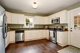 paint vs stain kitchen cabinets should you stain or paint your kitchen cabinets