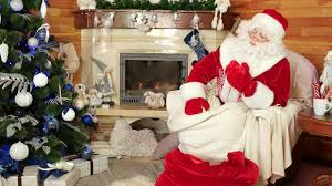 santa packing bag with christmas presents room with fireplace