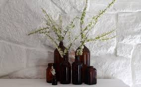stone fireplaces and amber bottles with spring blooms most