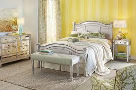 bedroom mirror mixed wooden bed frame in beige color scheme