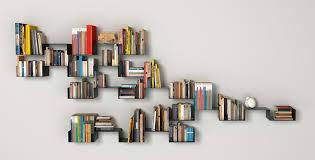 floating black steel random shelves for books placed on the gray