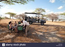 african jeep tourists having breakfast on an african jeep safari holiday