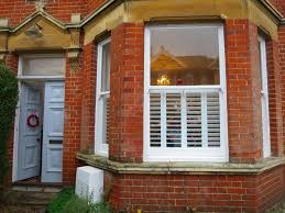 tier on tier bay window shutters fitted in winchester shuttersouth