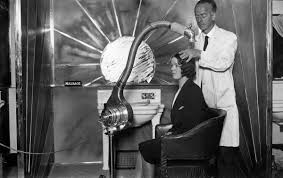 old fashinoned hairdressers and there salon potos early hair dryers looked like terrifying sci fi experiments