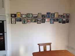 unique ways to hang pictures unusual ways hang display frame dma homes 34339