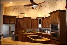 ceramic tile countertops dark oak kitchen cabinets lighting