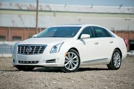 lincoln mks vs cadillac xts 2013 cadillac xts our review cars com
