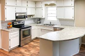 how to paint kitchen cabinets without streaks tips for refinishing kitchen cabinets this house