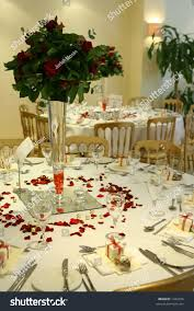 Red Rose Table Centerpieces by Wedding Reception Setting Showing Tables Chairs Stock Photo
