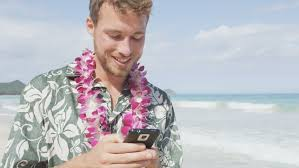 Hawaii travel man images Man texting using smart phone app on smartphone on hawaii beach jpg