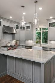 gray kitchen cabinets with white crown molding warm grey luxury kitchen remodel kitchen remodel