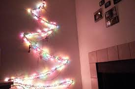christmas tree shaped lights couple turn fairy lights into a christmas tree every year for a