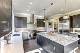 are white quartz countertops in style modern gray kitchen features gray flat front cabinets paired