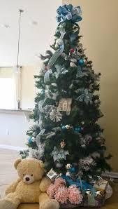 traditional christmas tree with colored lights slightly coastal