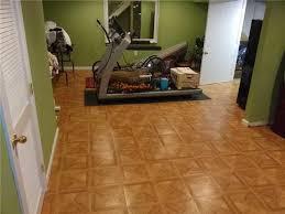 How To Finish Basement Floor - quality 1st basement systems photo album warm finished basement