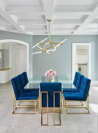 brass glass dining table jonathan adler goldfinger blue velvet dining chairs frame a stunning