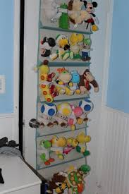 cute stuffed animal storage ideas with door toy storage unit and