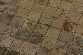what causes ceramic floor tiles to hunker