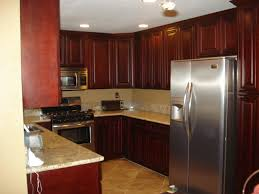 u shaped brown wooden cherry kitchen cabinet with marble