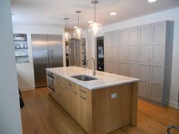 white countertop with wood base contrasting with painted built in