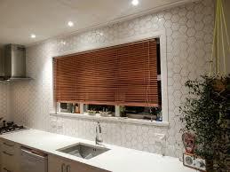 kitchen tiles ideas for splashbacks a marble herringbone tile kitchen splashback from the 2015 reno