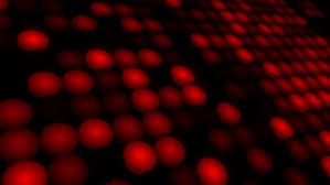 blurred small colorful lights on dark black background red green