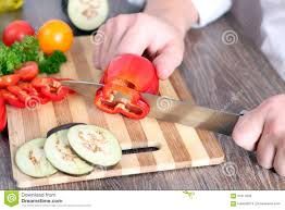 man chopping paprika on cutting board with knife in kitchen stock board chopping concept cooking cutting family food kitchen knife