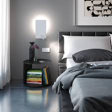 bedside sconces best wall sconce styles for your bedroom modern bedside sconces bedside light shining white lamp above unique table books pillow bed grey