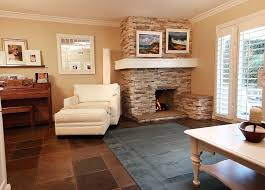 corner brown brick fireplace combined with white floating shelf