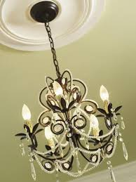 how to hang a heavy light fixture from the ceiling how to install a decorative ceiling medallion hgtv