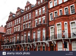 homes of the wealthy red brick houses in cadogan square stock