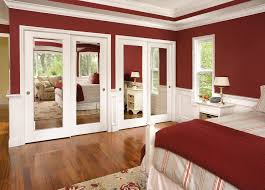 modern mirror closet and white master bed to look roomy of exotic modern mirror closet and white master bed to look roomy of exotic bedroom sliding door with maroon wall laminate flooring looks clean