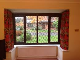 House Design Bay Windows by Metal Curtain Pole For A Box Bay Window Only Three Brackets