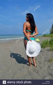 black hair for the beach a lovely young woman in a turquoise bikini and long black hair