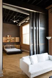 studio room dividers bedroom rustic with bed brick wall ceiling