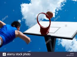 low angle view of a basketball player shooting a goal stock photo