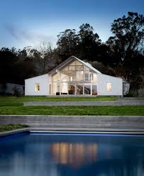 white barn like house with modern features digsdigs