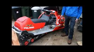 how to change a track on a snowmobile youtube