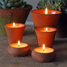 scented candles in flower pots by the wedding of my dreams