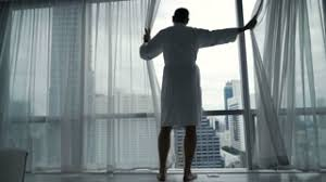 At Home Curtains Silhouette Of Man Unveil Curtains And Admire View From Window At