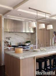 kitchen island with two different countertop materials overhang