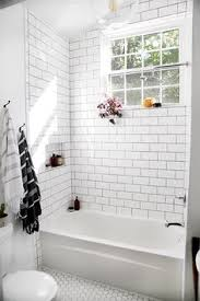 white subway tile with delorean grey grout with moen shower head