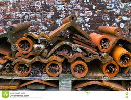 insect hotel recycled wood terracotta flower pots and roof til