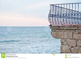 balcony fence in front of the sea in sitges spain stock image