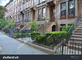 brownstone homes books on property ground stock photo 113917561