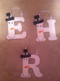 painted wooden snowman letter ornaments by paintingsbystacey
