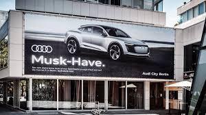 audi e tron sportback billboard takes jab at tesla