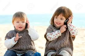 portrait two cute girls o talking on mobile phones