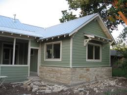 home exterior painted with sherwin williams clary sage paint